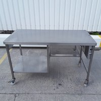 Stainless steel table on castors