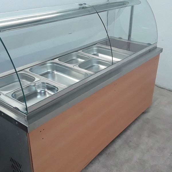Serving trolley with curved glass