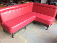 Red upholstered corner bench seating