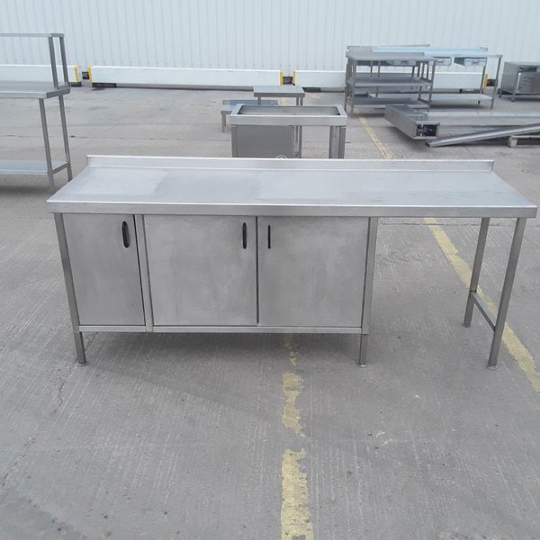 Used   Stainless Steel Table. 3 x Door cabinet