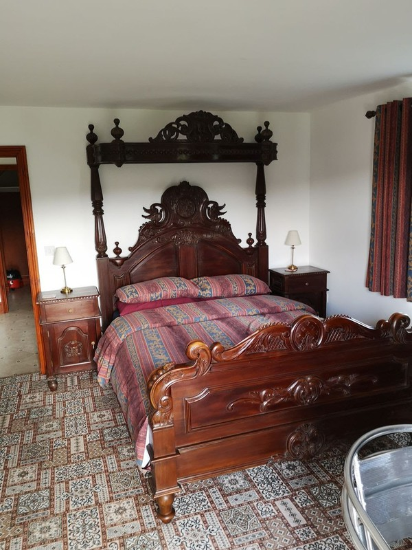 Carved hotel bed