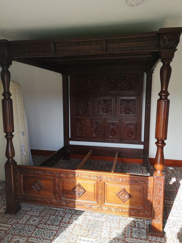 Carved mahogany four poster bed