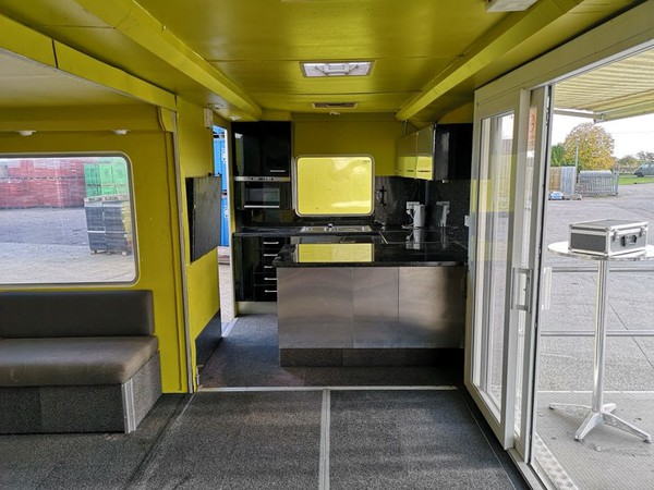 Yellow Exhibition Trailer with slide-out seating area