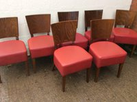 Wooden dining chairs with red seats
