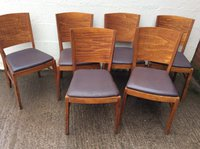 Wooden chairs with aubergine seat pads