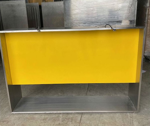 Stainless steel and yellow shop counter