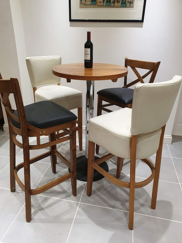 4 faux leather and wood high stools and table for sale