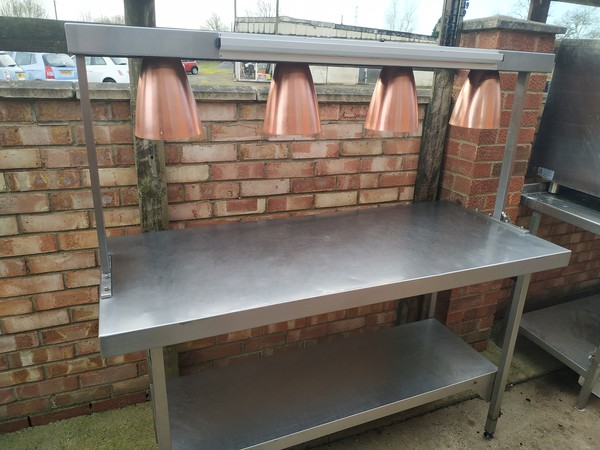 Stainless steel table with Chef's pass