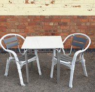 6 No. Aluminium tables each with 2 stackable aluminium chairs
