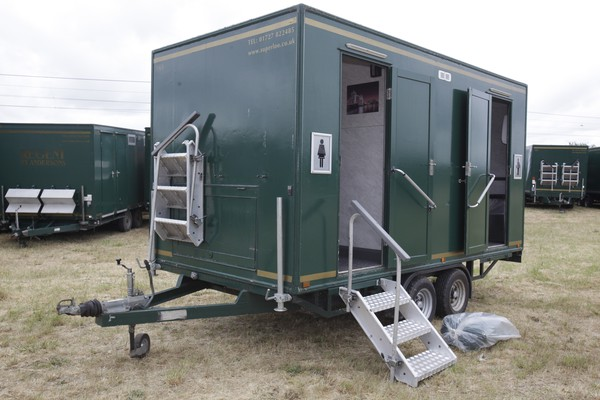 Green toilet trailer with aluminium steps