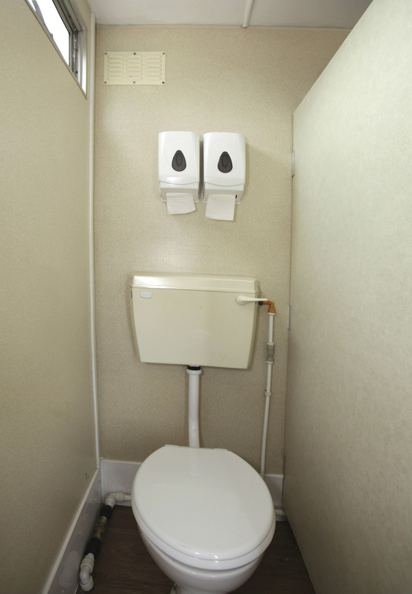 Toilet cubicle in gents trailer