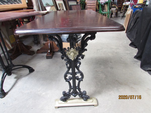 Traditional pub table with cast iron base
