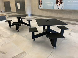 Square tables with fixed chairs