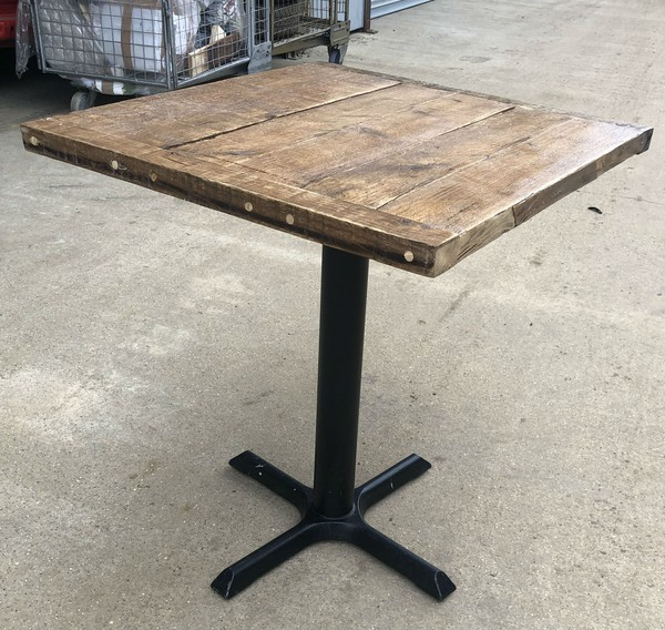 Table with reclaimed plank top and pedestal base