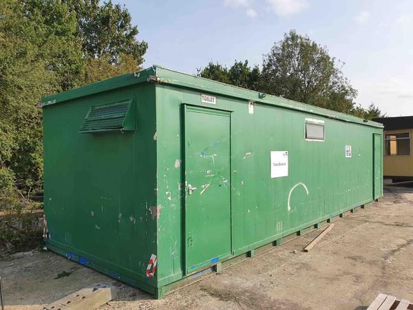 Large green men's toilet block