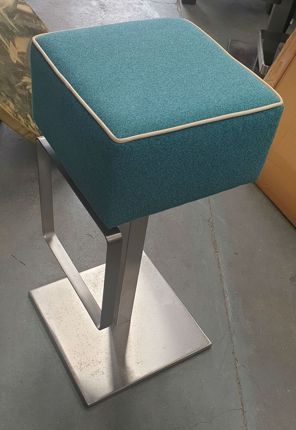Brushed steel and Turquoise Upholstery