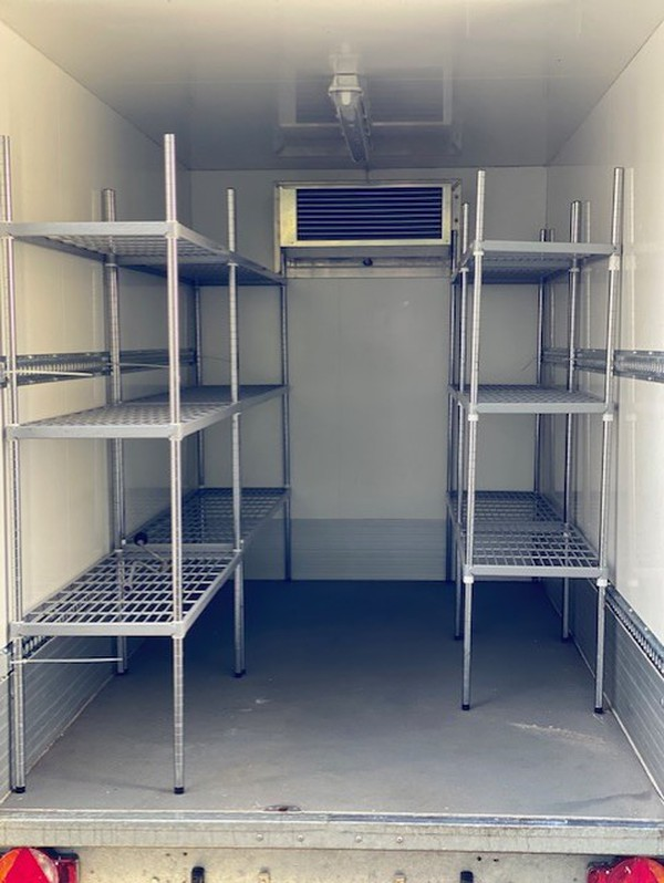 Walk in refrigerated trailer with internal shelving