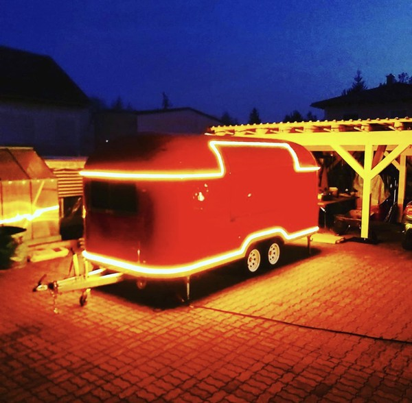 Red catering trailer with LED lighting
