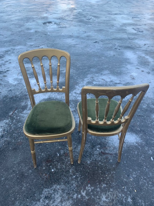 Gold Cheltenham chairs with green seat pads