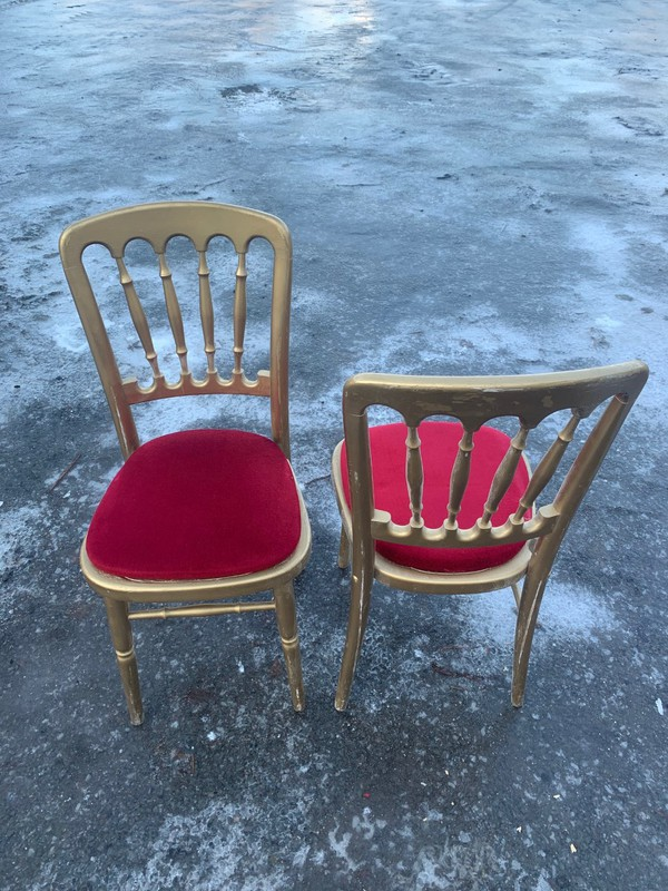 Gold Cheltenham chairs with red seat pads