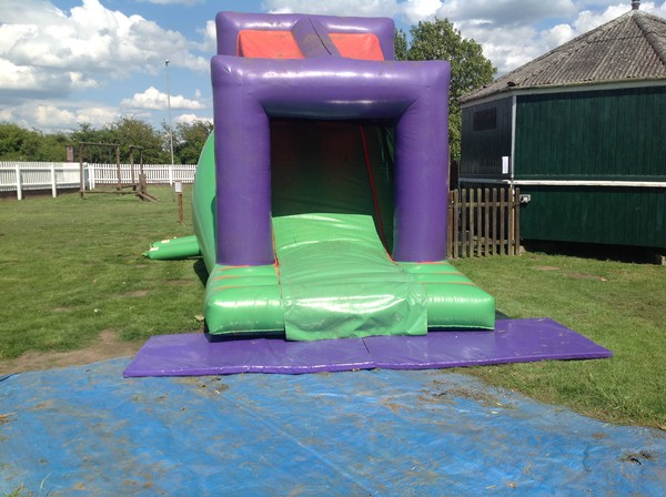 Bouncy obstacle course with slide