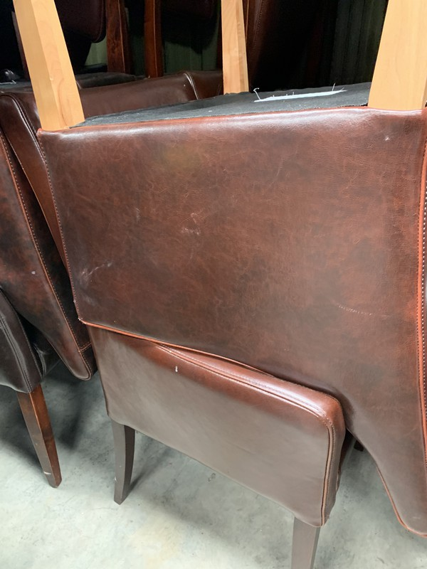 Brown leather tub chairs