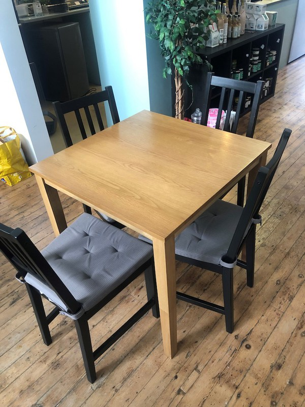 square wooden tables with contrasting chairs