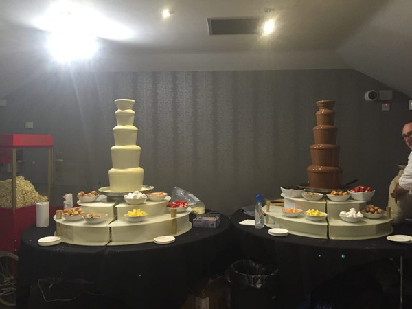 Milk and white chocolate fountains