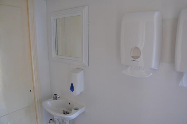 Hand wash sink with mirror