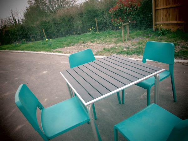 Square Tables and Emerald Green Chairs