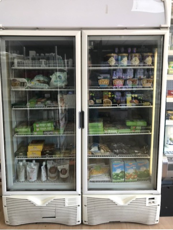 Double display freezer with glass doors