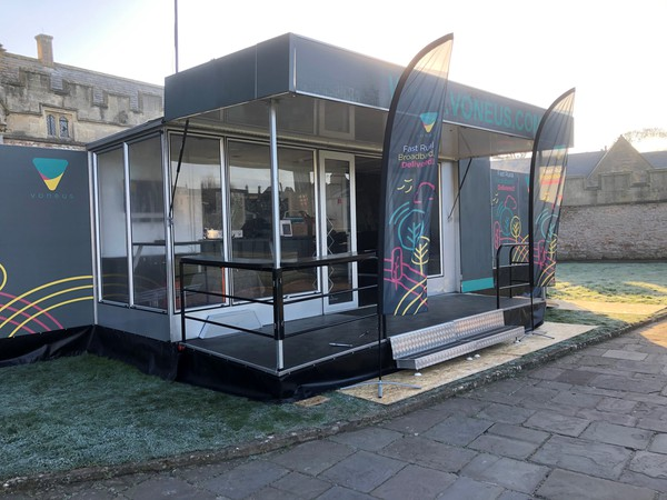 Exhibition trailer with slide out and stage / platform