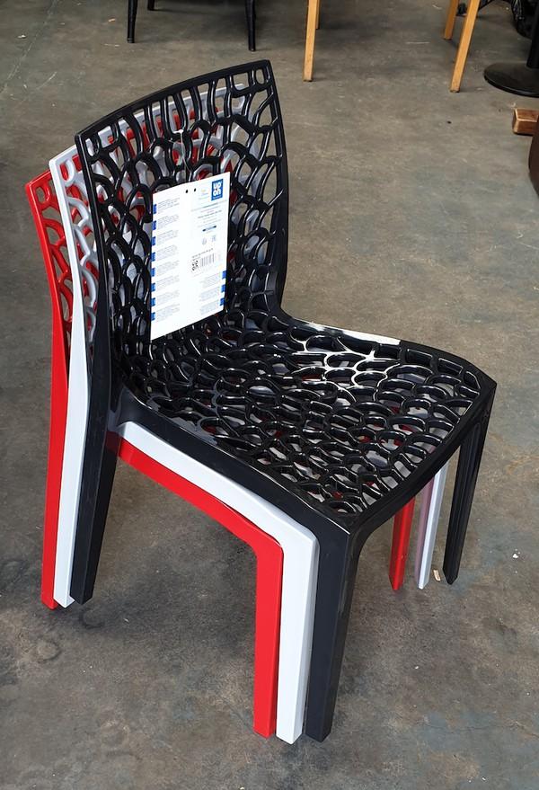 Stacking Black Neptune Chairs