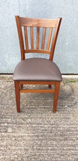 Houston chairs finished in Walnut stain and Brown faux leather seat