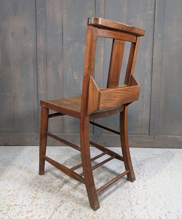 Splatback chapel chairs with bibel shelf
