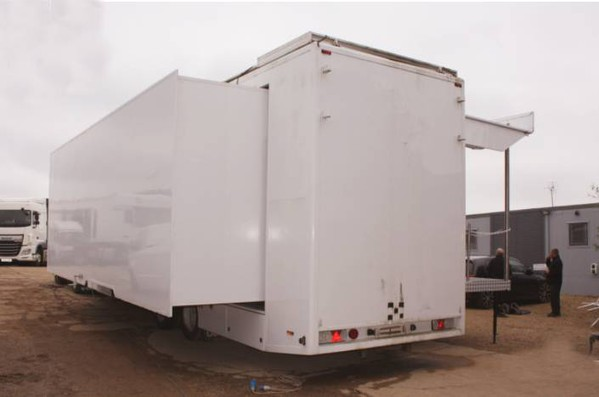 Articulated trailer stage with pull out and stage deck