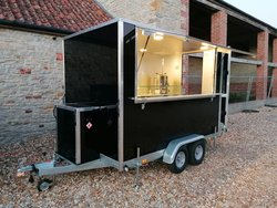 Black catering trailer with large hatch
