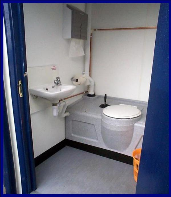 Toilet cubicle in a jack leg cabin