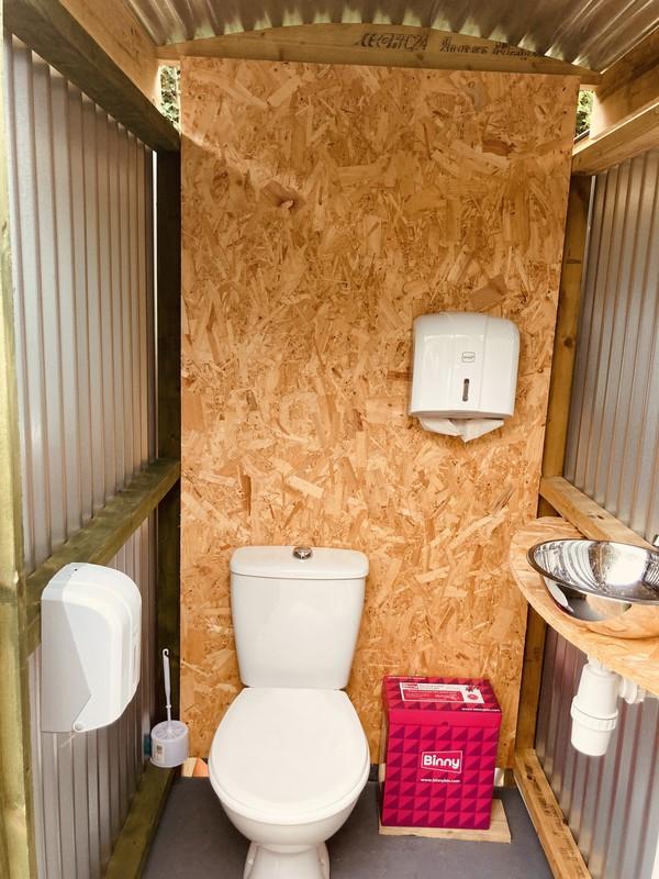 Rustic glampsite toilet unit