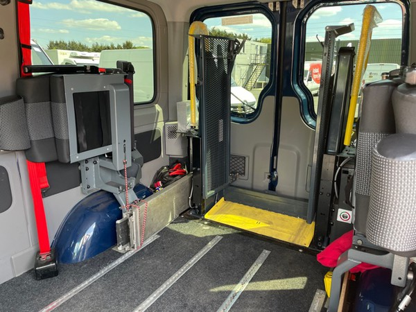 Wheel chair lift and folding back seats