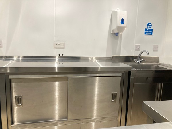 Stainless steel cupboard with stainless steel prep area