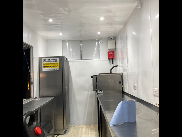White wipe down walls and stainless steel units