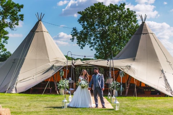 Bride and groom in front of Tipi