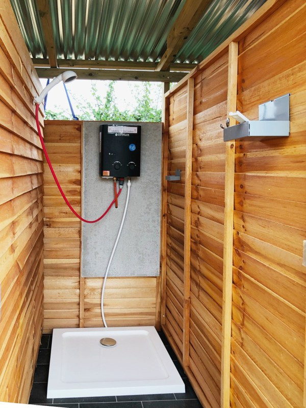 Glamping shower with corigated Iron roof
