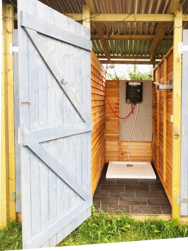 LPG Glamping showers - rustic wood