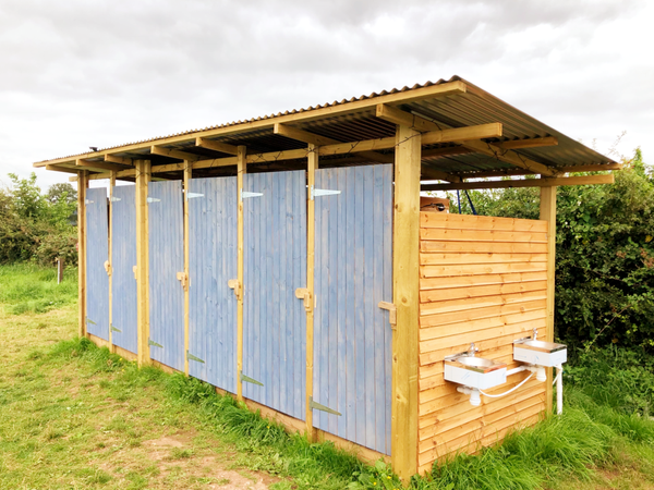 Six bay wooden shower block with corigated Steel roof