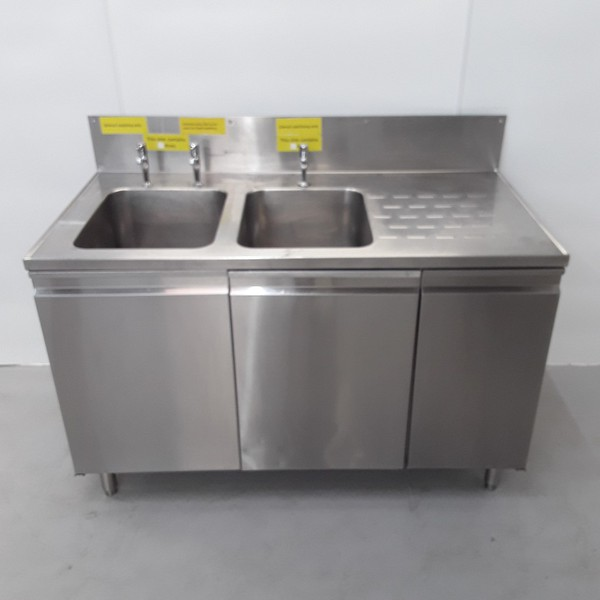 Double sink with kitchen cupboards