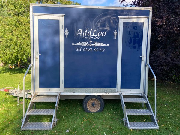 Blue 1 + 1 toilet trailer