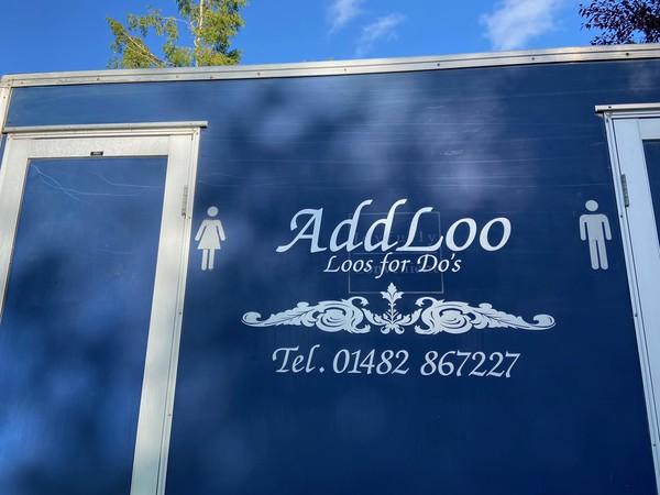 Blue toilet trailer