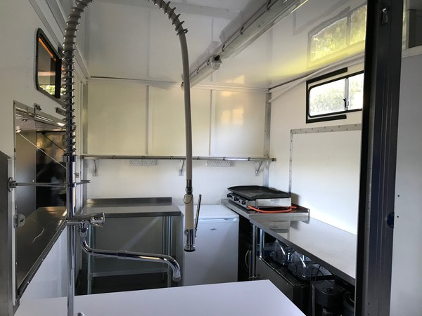 Clean white interior of a catering van